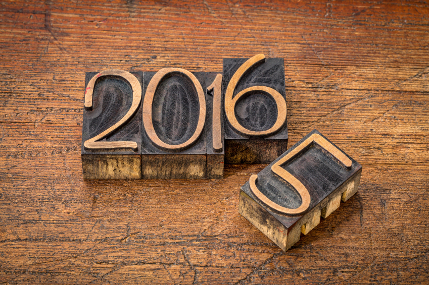 new year 2016 replacing the old year 2015 - letterpress wood type on a grunge wooden surface